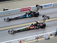 Jul 29, 2018; Sonoma, CA, USA; NHRA top fuel driver Terry McMillen (near) races alongside Scott Palmer during the Sonoma Nationals at Sonoma Raceway. Mandatory Credit: Mark J. Rebilas-USA TODAY Sports