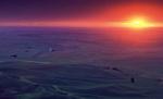 An intense sun radiates outward like a nuclear detonation on the horizon of the Palouse of Eastern Washington State.