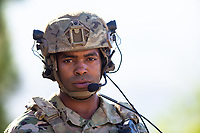 African American US military soldier in uniform outside in the desert. For sale as stock photography, DOD complient.
