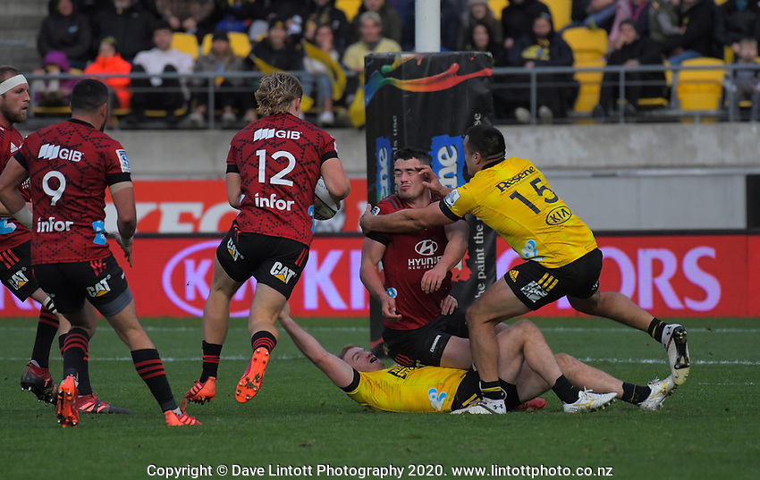 Jack Goodhue (12) takes a pass before scoring during the Super Rugby Aotearoa match between the Hurricanes and Crusaders at Sky Stadium in Wellington, New Zealand on Saturday, 21 June 2020. Photo: Dave Lintott / lintottphoto.co.nz