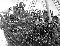 Home Again.  Returning soldiers on the Agamemnon. Hoboken, N.J. Troops arriving from France, ca.  1919 (Army)<br /> Exact Date Shot Unknown<br /> NARA FILE #:  111-SC-67079<br /> WAR & CONFLICT BOOK #:  716