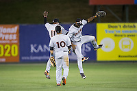 (L-R) Cedric Mullins (11), D.J. Stewart (10), and Gerrion Grim (18) celebrate their win over the Kannapolis Intimidators at Kannapolis Intimidators Stadium on April 23, 2016 in Kannapolis, North Carolina.  The Shorebirds defeated the Intimidators 4-2.  (Brian Westerholt/Four Seam Images)