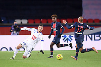 24th December 2020; Paris, France; French League 1 football, Paris St Germain versus Strasbourg;  LUDOVIC AJORQUE STRA slides in to control the ball
