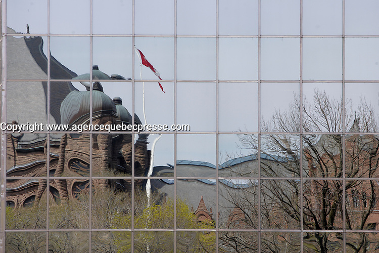 Toronto (ON) CANADA,  April , 2008-<br /> Reflection of The Ontario Legislature in Queens Park.<br /> <br /> urban park in the Downtown area of Toronto. Opened in 1860 by Edward, Prince of Wales, it was named in honour of Queen Victoria. The park is the site of the Ontario Legislature, which houses the Legislative Assembly of Ontario, and so the phrase Queen's Park is also frequently used to refer to the Government of Ontario.