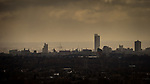 © Joel Goodman - 07973 332324 . 20/02/2014 . Manchester , UK . Landscape view across Manchester taken from Saddleworth near Oldham , featuring the city's iconic Beetham Tower to the right of centre , the Manchester City Stadium ( Etihad )  in the centre . Photo credit : Joel Goodman