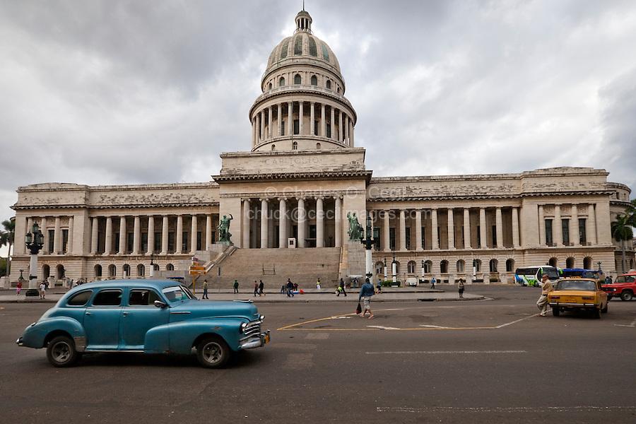 Cuba, Havana.  Capitol Building, dedicated 1929. Old American Car on the Paseo de Marti.