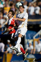 Akron's Zarek Valentin (2) leaps high for a ball. 2010 NCAA D1 College Cup Championship Final Akron defeated Louisville 1-0 at Harder Stadium on the campus of UCSB in Santa Barbara, California on Sunday December 12, 2010.