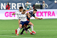 FOXBOROUGH, MA - APRIL 24: Matt Polster #8 of New England Revolution attempts to control the ball as Russell Canouse #6 of D.C. United pressures during a game between D.C. United and New England Revolution at Gillette Stadium on April 24, 2021 in Foxborough, Massachusetts.