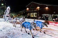 Nick Petit runs down the chute at the finish line in Nome, Alaska early on Wednesday morning March 14th as places 2nd in the 46th running of the 2018 Iditarod Sled Dog Race.  <br /> <br /> Photo by Jeff Schultz/SchultzPhoto.com  (C) 2018  ALL RIGHTS RESERVED