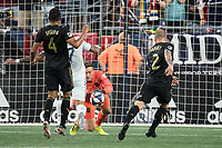 FOXBOROUGH, MA - AUGUST 3: Tyler Miller #1 of Los Angeles FC dives to save a goal during a game between Los Angeles FC and New England Revolution at Gillette Stadium on August 3, 2019 in Foxborough, Massachusetts.