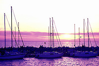 White Rock, BC, British Columbia, Canada - Sailboats docked at White Rock Pier in Semiahmoo Bay, Sunset