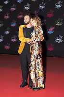 French singer Claudio Capeo (L) and a guest pose on the red carpet as she arrives to attend the 21st NRJ Music Awards ceremony at the Palais des Festivals in Cannes, southeastern France, on November 9, 2019<br /> Le chanteur français Claudio Capeo (G) et son invitee posent sur le tapis rouge lors de son arrivee a la 21e ceremonie des NRJ Music Awards au Palais des Festivals a Cannes, dans le sud-est de la France - le 9 novembre 2019.<br /> Eric Dervaux_ DALLE
