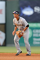 Second baseman Gosuke Katoh (16) of the Charleston RiverDogs follows a grounder in a game against the Greenville Drive on Sunday, May 24, 2015, at Fluor Field at the West End in Greenville, South Carolina. Charleston won 3-2. (Tom Priddy/Four Seam Images)