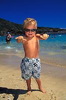 Young boy at Hanauma Bay East Oahu, flashing the shaka sign.