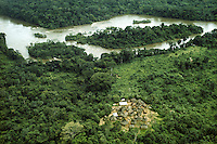 Africa, Liberia, Kpelle Tribe: aerial view of small village and Saint Paul River in rainforest.