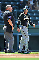 Head coach Todd Interdonato of the Wofford Terriers talks to home plate umpire Andy Glenn in a SoCon Tournament game against Western Carolina on Wednesday, May 25, 2016, at Fluor Field at the West End in Greenville, South Carolina. Western won, 10-9. (Tom Priddy/Four Seam Images)