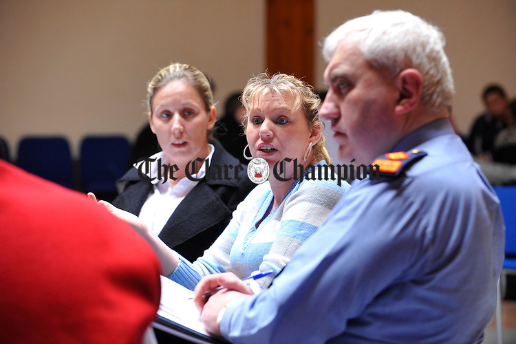 """Bridget Sherlock and Kathleen Mc Donagh, make their point as Superintendent John Scanlan listens on during a group forum at the launch of """"experiences and Perspectives of Ennis Travellers of the County Clare Traveller Accomodation Programme 2000-2004. Photograph by John Kelly."""
