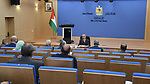 Palestinian Prime Minister Mohammad Ishtayeh, chairs the weekly meeting of his government, in the West Bank city of Ramallah on August 30, 2021. Photo by Prime Minister Office