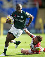 Topsy Ojo of London Irish goes round Freddie Burns of Gloucester Rugby during the Aviva Premiership match between London Irish and Gloucester Rugby at the Madejski Stadium on Saturday 8th September 2012 (Photo by Rob Munro)