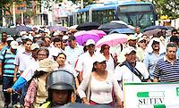 CALI -COLOMBIA-20-08-2013. Más de 400 personas que salieron del parque de las Banderas de Cali a hacer parte de la marcha nacional en el marco del paro nacional agrario que hoy se desarrolló en todo el país, empleados del hospital Universitario, magisterio, estudiantes y transportadores hicieron parte de los manifestantes que terminaron en la gobernación del Valle./ More than 400 people came out from Parque de las Banderas of Cali to be a part of national march as a part of agrarian national strike that had developed across the country; university hospital workers, teaching, students, transporters took part of the protesters that finish the mach in front of governorship of the Valle department.  Photo: VizzorImage/Juan C. Quintero/STR