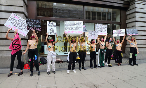 Topless Protesters outside H&M Oxford Street<br /> Extinction Rebellion demonstrators hold a Redress the Injustice day of protest around Central London, opposing the fashion industry's many human, animal and environmental injustices. September 9th 2020<br /> CAP/ROS<br /> ©ROS/Capital Pictures