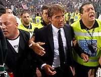 Calcio, Supercoppa di Lega: Juventus vs Lazio. Roma, stadio Olimpico, 18 agosto 2013<br /> Juventus coach Antonio Conte reacts at the end of the Italian League Supercup football final match between Juventus and Lazio, at Rome's Olympic stadium,  18 August 2013. Juventus won 4-0.<br /> UPDATE IMAGES PRESS/Riccardo De Luca