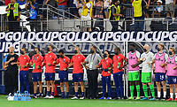 DALLAS, TX - JULY 25: The USMNT Coaches and Trainers stand for the National Anthem before a game between Jamaica and USMNT at AT&T Stadium on July 25, 2021 in Dallas, Texas.