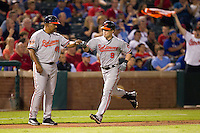 Baltimore Orioles outfielder Nate McClouth #9 rounds third base after homering in the Major League Baseball game against the Texas Rangers on August 21st, 2012 at the Rangers Ballpark in Arlington, Texas. The Orioles defeated the Rangers 5-3. (Andrew Woolley/Four Seam Images).