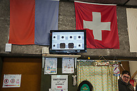 "Switzerland. Canton Ticino. Cureglia is a municipality in the district of Lugano. Shooting range. Marco Castelli is one of the members of ""Tiratori del Gaggio"" society. On the wall, Ticino and Swiss flags. Tv screen with electronic devices showing targets and the shots's points. Young shooters' course. The courses, whose organisation is delegated by the Federal Department of Defence, Civil Protection and Sport to the various local shooting societies, are open to young swiss people, boys and girls, from 15 to 20 years old. Girls and boys learn how to handle and fire with the assault rifle SG 550, also called Fass 90, used by the Swiss Army. The SG 550 is an assault rifle manufactured by Swiss Arms AG (formerly Schweizerische Industrie Gesellschaft) of Neuhausen, Switzerland. ""SG"" is an abbreviation for Sturmgewehr, or ""assault rifle"". The rifle is known as the Fass 90 or Stgw 90. An assault rifle is a selective-fire rifle that uses an intermediate cartridge and a detachable magazine. 9.02.2019 © 2019 Didier Ruef"