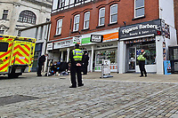 Police and the ambulance service attend an incident in which a man was given first aid on the ground in Union Street, Swansea, Wales, UK. Saturday 15 May 2021