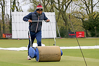 Kishen Velani of Wanstead CC attempts to dry the playing area after heavy rain fell ahead of Wanstead and Snaresbrook CC vs Hornchurch CC, Hamro Foundation Essex League Cricket at Overton Drive on 8th May 2021