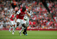 Pictured: Joe Allen of Swansea (R) is kept at bay by Emmanuel Frimpong of Arsenal (L). Saturday 10 September 2011<br /> Re: Premiership Arsenal v Swansea City FC at the Emirates Stadium, London.