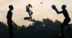 04/11/2004:  Journal photo by Ted Richardson:  Kids play baseball at high-noon on the asphalt in Havana.  They often used a wad of gaffer's tape for a ball, sometimes a plastic soda cap.