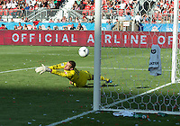 18 August 2012: Toronto FC goalkeeper Milos Kocic #30 can't stop a shot on goal by Sporting KC forward Kei Kamara #23 during an MLS game between Sporting Kansas City and Toronto FC at BMO Field in Toronto, Ontario Canada..Sporting Kansas City won 1-0.