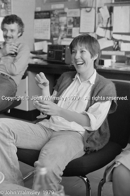 Carole Aikman and Tom Bonnar, Art Dept staff room, Wester Hailes Education Centre, Wester Hailes, Scotland, 1979.  John Walmsley was Photographer in Residence at the Education Centre for three weeks in 1979.  The Education Centre was, at the time, Scotland's largest purpose built community High School open all day every day for all ages from primary to adults.  The town of Wester Hailes, a few miles to the south west of Edinburgh, was built in the early 1970s mostly of blocks of flats and high rises.