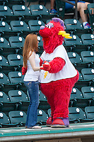 "Winston-Salem Dash mascot ""Bolt"" dances with a young fan between innings of the game against the Frederick Keys at BB&T Ballpark on July 30, 2014 in Winston-Salem, North Carolina.  The Dash defeated the Keys 12-2.   (Brian Westerholt/Four Seam Images)"