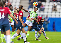 REIMS, FRANCE - JUNE 8: Kristine Minde #17 of Norway defends Francisca Ordega #17 of Nigeria in the box during a 2019 FIFA Women's World Cup match between Norway and Nigeria at Stade Auguste-Delaune on June 8, 2019 in Reims, France.