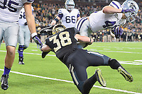 Kansas State full back Glenn Gronkowski (48) is brought down by Baylor nickelback Collin Brence (38) during an NCAA football game, Saturday, December 06, 2014 in Waco, Tex. Baylor defeated Kansas State 38-27. (Mo Khursheed/TFV Media via AP Images)