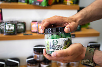 LISBON, PORTUGAL - APRIL 20: A person opens a CBD edibles inside a CBD shop in Lisbon, on April 20, 2021. <br /> First cannabis-based substance for medicinal purposes approved, The National Authority for Medicines and Health Products (Infarmed) has approved the first substance based on the cannabis plant for medicinal purposes in Portugal. (Photo by Luis Boza/VIEWpress)