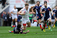 Phil Burgess of England is brought down by Terry Bouhraoua of France during Day Two of the iRB Marriott London Sevens at Twickenham on Sunday 11th May 2014 (Photo by Rob Munro)