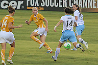 Karen Carney (14) of the Chicago Red Stars looks to pass and the Atlanta Beat defends. The Atlanta beat defeated the Chicago Red Stars during a Women's Professional Soccer (WPS) match at KSU Atlanta Beat Stadium Kennesaw, GA, on July 21, 2010.