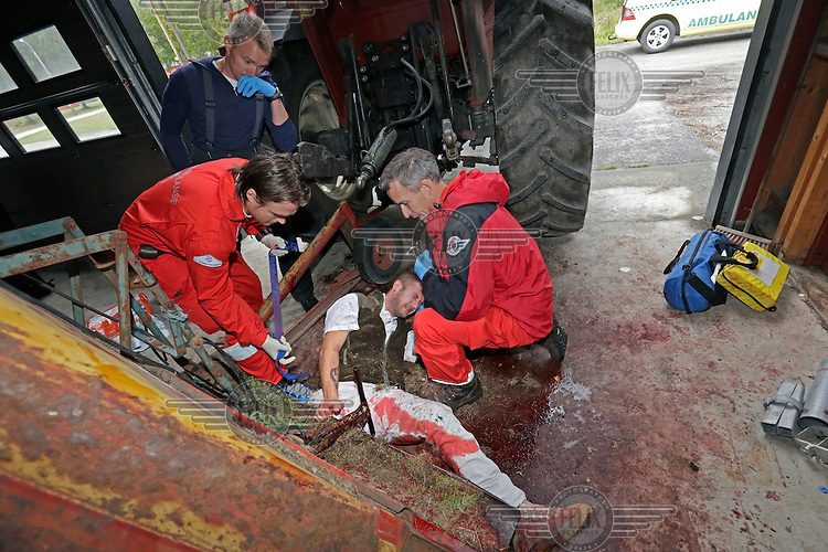 Doctor Lars O.Fjose (right) and rescue paramedic  Arnt Ole Mathisen work on a patient  during an exercise. Pilot Hans Ivar Kubberød in the background. <br /> <br /> Amputee Will Scott plays the victim in the  medical simulation