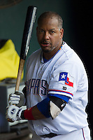 Round Rock Express designated hitter Manny Ramirez (99) warms up in the dugout before being called as a pinch hitter during the Pacific Coast League baseball game against the Salt Lake Bees on August 10, 2013 at the Dell Diamond in Round Rock, Texas. Round Rock defeated Salt Lake 9-6. (Andrew Woolley/Four Seam Images)