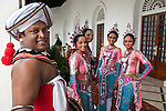 """Traditional dancers and musicians prepare to lead a fanfare at a morning wedding reception at The Galle Face Hotel. Founded in Colombo, Sri Lanka in 1864, is the oldest hotel east of Suez. It is located off Galle Road, the main highway in the City of Colombo.The hotel borrowed its name from this charming way back of """"Galle Face Green"""" in 1864, built by four British entrepreneurs who were looking to start a business in the city..Mignonne Fernando and The Jetliners regularly entertained guests at the Coconut Grove, the night club attached to the hotel. The venue was even popularised in a song. Radio Ceylon recorded music programmes from the Coconut Grove as well as the Galle Face Hotel itself, presented by some of the legendary Radio Ceylon announcers in the 1950s and 1960s, such as Livy Wijemanne and Vernon Corea. Thousands listened to the broadcasts, particularly 'New Year's Eve' dances from the Galle Face Hotel..D.G. William (known as 'Galle Face William'), the Lanka Sama Samaja Party trade union leader, first worked and organised workers here. The Science fiction author Arthur C. Clarke wrote the final chapters of 3001 - The Final Odyssey in the hotel..It regularly featured on the itineraries of royalty . Princess Alexandra of Denmark commented that 'the peacefulness and generosity encountered at the Galle Face Hotel cannot be matched'. Former guests include the first man in space, Yuri Gagarin, former British Prime minister Edward Heath, the journalist Eric Ellis and Prince Sadruddhin Aga Khan, Rigger Bone Sconi, Lord Louis Mountbatten, 1st Earl Mountbatten of Burma and Marshal Josip Broz Tito."""