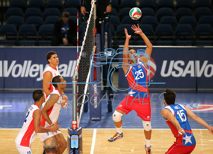 Puerto Rico's Juan Ruiz sets against Dominican Republic during the Pan American Cup at the Reno Events Center in Reno, Nev., on Monday, Aug. 17, 2015. <br /> Photo by Cathleen Allison