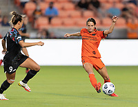 HOUSTON, TX - SEPTEMBER 10: Shea Groom #6 of the Houston Dash attempts to gain control of a loose ball during a game between Chicago Red Stars and Houston Dash at BBVA Stadium on September 10, 2021 in Houston, Texas.