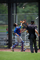 GCL Mets catcher Nelson Mompierre (9) tracks a pop up in front of home plate umpire Ryne Sigmon during a game against the GCL Nationals on August 4, 2018 at FITTEAM Ballpark of the Palm Beaches in West Palm Beach, Florida.  GCL Nationals defeated GCL Mets 7-4.  (Mike Janes/Four Seam Images)