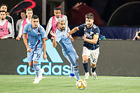 FOXBOROUGH, MA - SEPTEMBER 29: Carles Gil #22 of New England Revolution breaks free from a tackle by Maximiliano Moralez #10 of New York City FC during a game between New York City FC and New England Revolution at Gillettes Stadium on September 29, 2019 in Foxborough, Massachusetts.