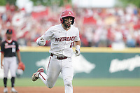 Arkansas catcher Casey Opitz (12) runs home for a score, Monday, June 7, 2021 in the NCAA Fayetteville Regional at Baum-Walker Stadium in Fayetteville. Check out nwaonline.com/210608Daily/ for today's photo gallery. <br /> (NWA Democrat-Gazette/Charlie Kaijo)