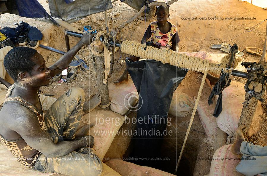 BURKINA FASO , Fada N´Gourma, village TINDANGOU, gold mining Camp PAMA, artisanal gold mines, boy ISSAKA ZONGO, 10 years old, must ventilate manually the pit mine with fresh air